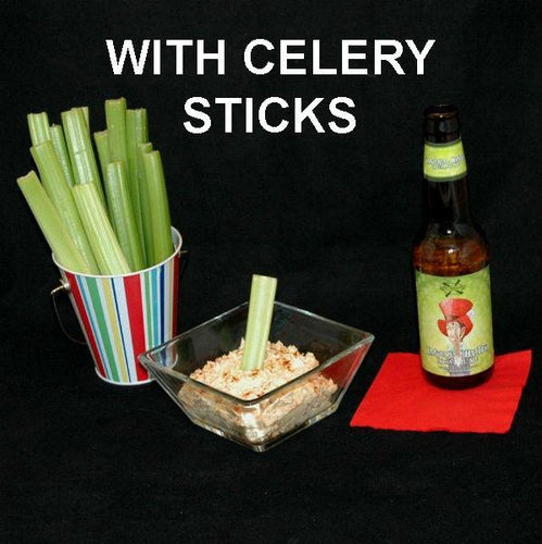 Celery stalks to dip in Buffalo Garlic Blue Cheese Dip, with ale