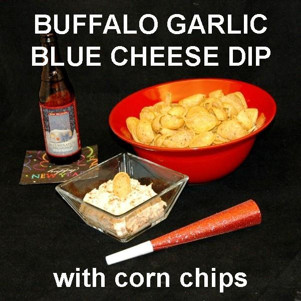 Buffalo Garlic Blue Cheese Dip with corn chips served with ale New Year's