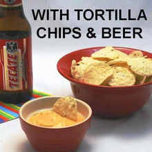 Load image into Gallery viewer, Caliente Cheddar Dip with totillla chips served with Mexican beer
