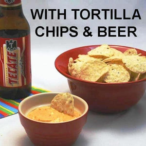 Caliente Cheddar Dip with totillla chips served with Mexican beer