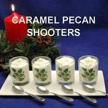 Load image into Gallery viewer, Caramel Pecan Mousse in holly shot glasses for tasting Christmas