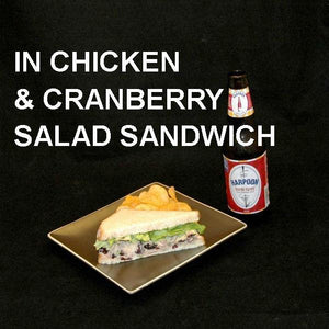 Chicken Salad Sandwich with Craisins®, green onions, Sweet Ginger Cranberry Dressing on sourdough bread, served with ale