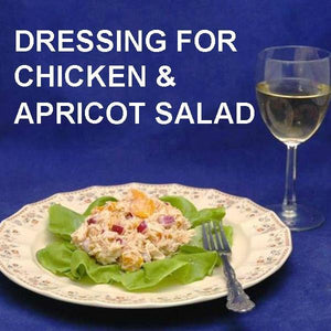Chicken Salad with apricots, red onions and Sweet Ginger Apricot Dressing on bibb lettuce, served with white wine