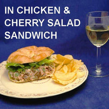 Load image into Gallery viewer, Chicken Salad Sandwich with cherries, green onions and Sweet Ginger Cherry Dressing on croissant, served with chips and white wine