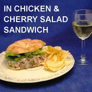 Chicken Salad Sandwich with cherries, green onions and Sweet Ginger Cherry Dressing on croissant, served with chips and white wine