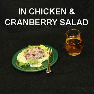 Chicken Salad with Craisins®, green onions and Sweet Ginger Cranberry Dressing, served on bibb lettuce with blush wine