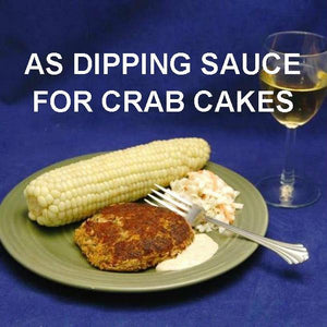Crab Cakes with Chipotle Ranch Dressing for dipping, served with corn , coleslaw and white wine