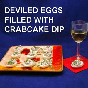 Deviled eggs filled with crab cake dip, served with white wine Valentines