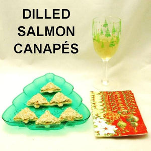 Dill Salmon spread on Christmas tree cutout toasts with white wine Christmas