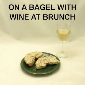 Dilled Smoked Salmon Spread on bagel served with white wine