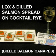Load image into Gallery viewer, Cocktail Rye spread with Dill Dip, topped with Lox, served with white wine July 4th