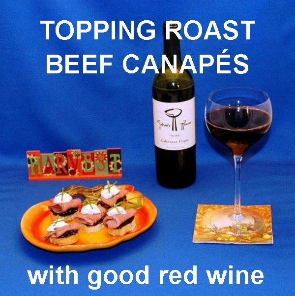Roast beef on baguette slices with garlic blue cheese spread and red wine Thanksgiving appetizer