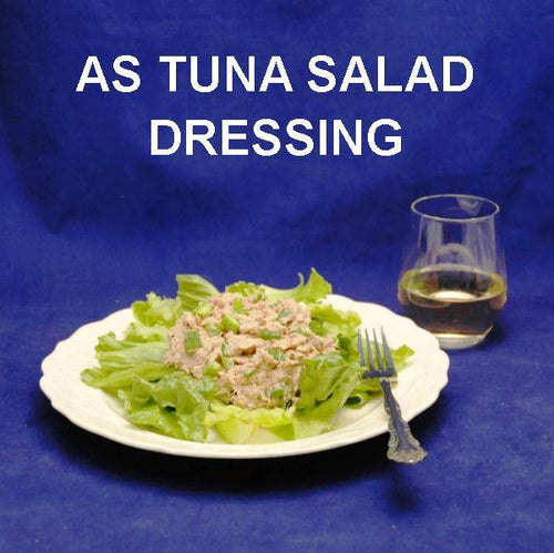 Ginger Sesame Tuna Salad on Butter Lettuce, served with white wine