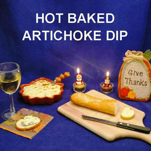 Baked Artichoke Dip on baguette slices with white wine Thanksgiving appetizer
