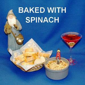 Hot baked Artichoke and Spinach Dip with baguette slices, served with a Cosmo Christmas