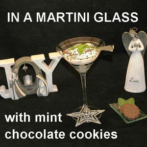 Irish Cream Mousse in martini glass with chocolate sprinkle and mint leaf garnish Christmas