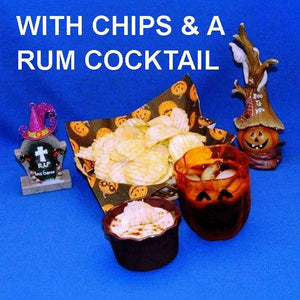Halloween Jamaican Orange dip with chips and a rum cocktail