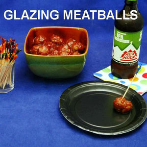 Jamaican Orange Chili Sauce Glazed Meatballs served with craft ale