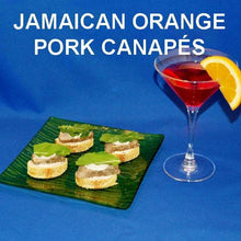 Load image into Gallery viewer, Jamaican Orange Pork Loin Canapés with white cheese and mint leaf garnish, served with cosmos