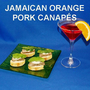 Jamaican Orange Pork Loin Canapés with white cheese and mint leaf garnish, served with cosmos