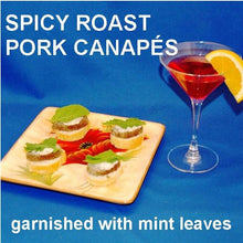 Load image into Gallery viewer, Jamaican Orange Pork Loin Canapés with white cheese and mint leaves garnish , served with a Cosmo Summer