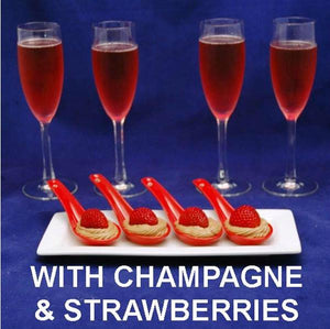Strawberries nestled in Kahlua Chocolate Mousse, served in red tasting spoons, with pink champagne
