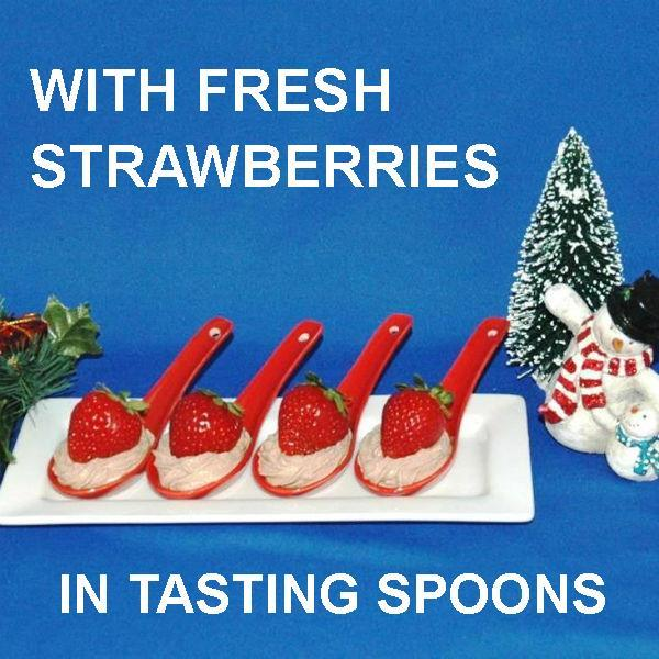 Strawberries nestled in Kahlua Chocolate Mousse, served in red tasting spoons Christmas