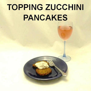 Lemon Pesto Dip topping zucchini pancakes, served with rose wine