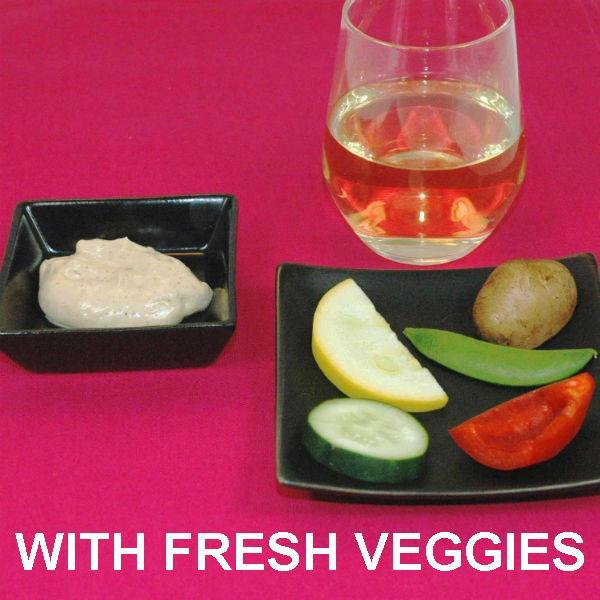 Madras mayonnaise and sour cream dip with fresh veggie dippers, served with white wine