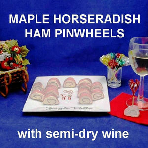 Ham Pin Wheels filled with Maple Horseradish Dip, party appetizer served with white wine Christmas