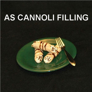 Cannoli filled with Pumpkin Mousse, garnished with chocolate sprinkles and drizzled with chocolate sauce