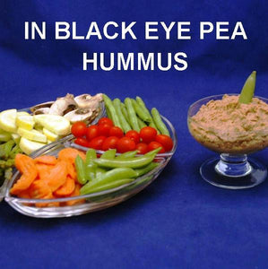 Spicy Queen of Sheba Black Eye Pea Hummus with fresh raw veggies for dipping