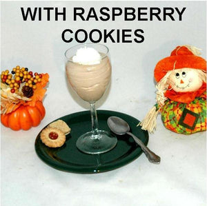 Raspberry Chocolate Mousse garnished with whipped cream and raspberry thumbprint cookies, served in wine glass Fall
