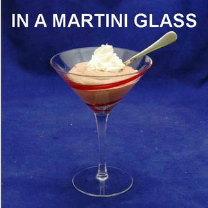 Raspberry Chocolate Mousse garnished with whipped cream, served in martini glass