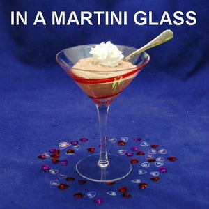 Raspberry Chocolate Mousse garnished with whipped cream, in martini glass Valentine's