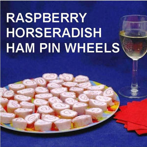 Ham Pin Wheels filled with Raspberry Horseradish Dip, served with white wine Summer