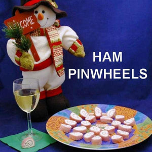 Ham Pin Wheels filled with Raspberry Horseradish cream cheese, served with white wine Christmas