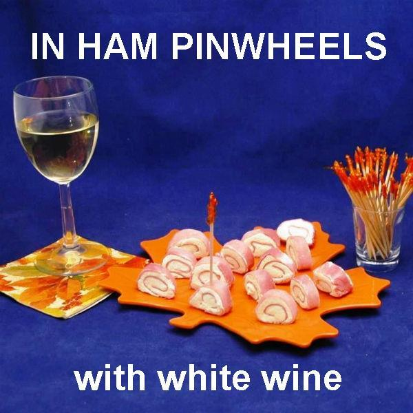 Ham Pin Wheels filled with Raspberry Horseradish Dip, served with white wine Fall