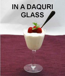 Raspberry Lemon Mousse garnished with fresh raspberries and mint in daiquiri glass