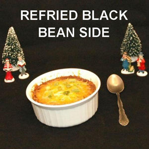 Spicy Rio Grande Refried Black Beans, garnished with melted cheddar cheese, side dish Christmas