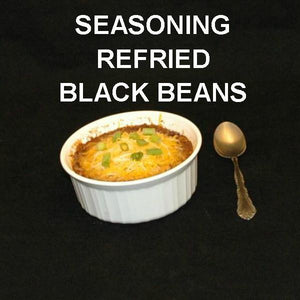 Rio Grande Refried Black Beans, garnished with melted cheddar cheese, side dish