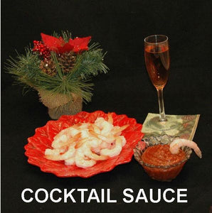 Steamed shrimp with Rio Grand Spiced Ketchup Cocktail Sauce, served with semi-dry blush wine Christmas