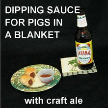 Load image into Gallery viewer, Pigs in a Blanket with Rio Grande Spiced Ketchup for dipping, served with Lemon Shandy ale Summer