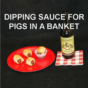 Pigs-in-a-Blanket with Roasted Garlic Spiced Ketchup for dipping, served with craft beer Summer