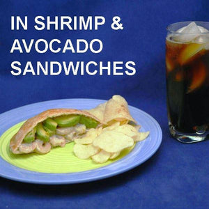 Spicy Mango Shrimp Salad and Avocado stuffed into pita bread, served with chips and cola