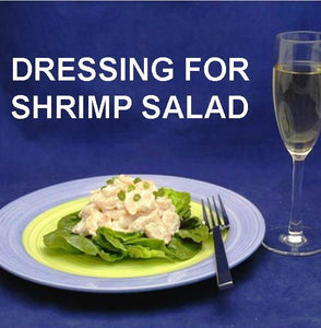 Spicy Mango Shrimp Salad on bibb lettuce, garnished with snipped chives, served with white wine