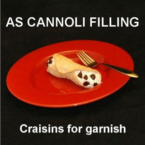 Cannoli filled with Spiked Eggnog Mousse, garnished with Craisin® pieces