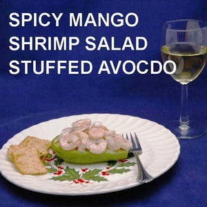 Half Avocado stuffed with Spicy Mango Shrimp Salad, served with white wine Christmas