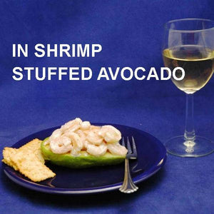Half Avocado stuffed with Spicy Mango Shrimp Salad, served with white wine