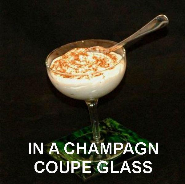 Spiked Eggnog Mousse served in coupe champagne glass, garnished with nutmeg sprinkles